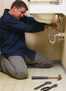 Plumber in Glendale AZ repairs a leaky sink