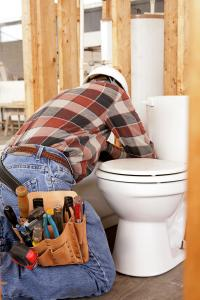 Plumber in Glendale AZ connects a toilet